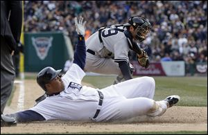 Detroit Tigers' Miguel Cabrera beats the tag of New York Yankees catcher Francisco Cervelli to score on a sacrifice fly by Victor Martinez during the fifth inning Saturday in Detroit.