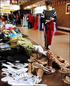 Shoes and purses also are lined up for purchase at the prom dress sale organized by the Owens Raising Awareness Club and Springfield High School Academic Boosters