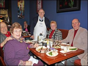 Perrysburg Municipal Court Judge S. Dwight Osterud, center, poses with diners at the Exchange Club of Perrysburg's celebrity wait night at Stella's.