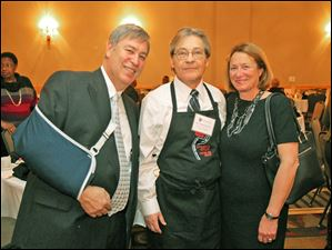 From left, Dave Quinn, Michael Eberly and Ann Marie Quinn pose for a photo during Eberly center's wait night fund-raiser.