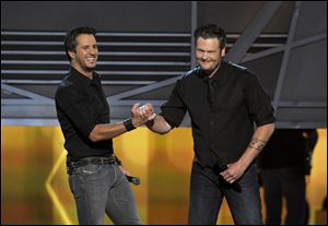 Luke Bryan, left, and Blake Shelton speak on stage at the 48th Annual Academy of Country Music Awards on Sunday at the MGM Grand Garden Arena in Las Vegas.
