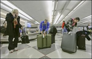 Travelers check luggage at a United Airlines baggage claim area at O'Hare International Airport in Chicago. United Airlines had the highest consumer complaint rate of the 14 airlines in a report being released today: 4.24 complaints per 100,000 passengers.