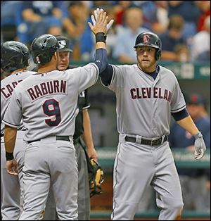 The Indians' Mark Reynolds, right, is congratulated after his three-run home run by teammate Ryan Raburn.