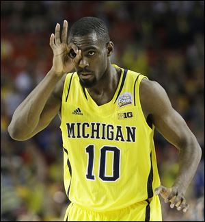 Tim Hardaway, Jr., and his Michigan teammates will eye a national championship when they play Louisville at 9:23 p.m. today in Atlanta.