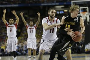 Wichita State's Fred Van Vleet tries to slip past Louisville's Tim Henderson on Saturday. Henderson, a former walk-on, has been playing since the injury to Kevin Ware.