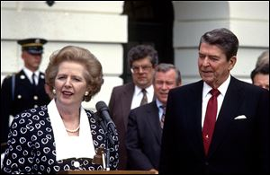 Prime Minister Margaret Thatcher of the United Kingdom, left, makes remarks after visiting United States President Ronald Reagan, right, at the White House in Washington, D.C., on July 17, 1987.