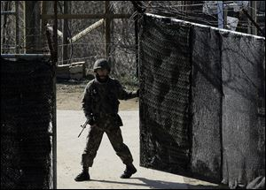 A South Korean soldier closes a military gate in Paju, north of Seoul, on Sunday. South Korean and U.S. officials believe North Korea may be setting the stage for another missile test, possibly as soon as this week.