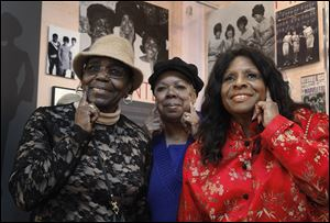 The Andantes, the unsung backing group which sang on thousands of Motown songs, from left, Jackie Hicks, Marlene Barrow-Tate, and Louvain Demps, pose during a visit to the Motown Historical Museum in Detroit.