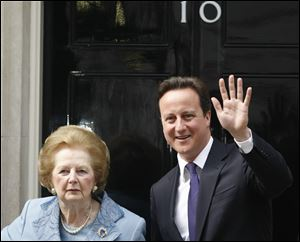 Britian's Prime Minister David Cameron poses with former Prime Minister Margaret Thatcher on the doorstep of 10 Downing Street  in London in June, 2010.