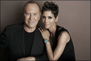 Michael Kors and actress Halle Berry pose for a photo at Kors' Midtown office in New York. Kors and Berry have announced a partnership with the U.N. World Food Programme to raise money and awareness to tackle the issue of world hunger.