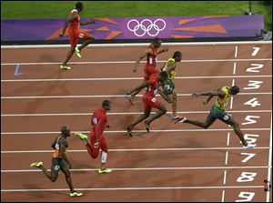Jamaica's Usain Bolt, right, crosses the finish line to win the men's 100-meter final race during the athletics competition in the Olympic Stadium at the 2012 Summer Olympics, London, last August.