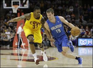 Orlando Magic's Beno Udrih (19), from Slovenia, drives past Cleveland Cavaliers' Alonzo Gee (33) during the first quarter Sunday night.