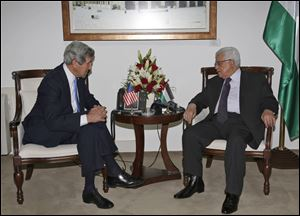 Palestinian President Mahmoud Abbas, right, meets Sunday with U.S. Secretary of State John Kerry in the West Bank city of Ramallah.