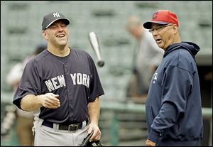 Yankees third baseman Kevin Youkilis talks with Indians manager Terry Francona, who was Youkilis' manager in Boston.
