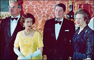 Margaret Thatcher, right, appears in 1984 with Queen Elizabeth II, West German Chancellor Helmut Kohl, left,and  President Ronald Reagan at London's Buckingham Palace for a dinner for summit leaders.