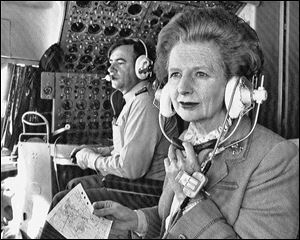 British Prime Minister Margaret Thatcher sits in the cockpit during a flight to Hong Kong from Beijing on Dec. 20, 1984.