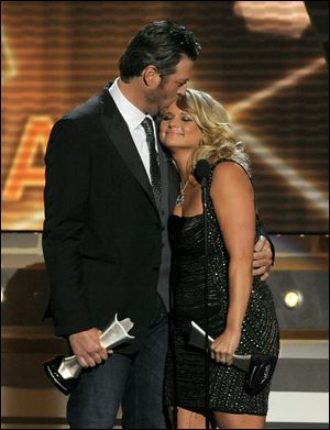 Miranda Lambert, right, and Blake Shelton accept the award for song of the year for