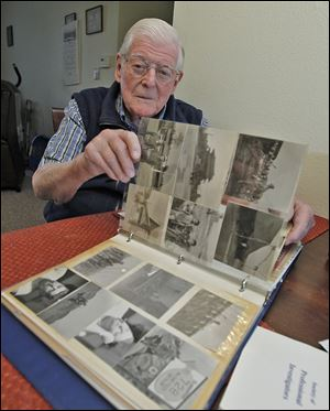 Korean War veteran Gene Meyer reviews his photo album inside his West Park Place apartment in Toledo as he shares his concern with the events and threats of war from the new North Korean leader.