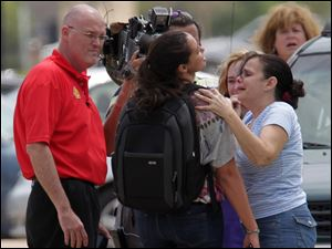 Lone Star College student Michelle Alvarez, second from right, is examined by her aunt Elena Tokarew, right,  after the stabbings at Lone Star College's Cypress-Fairbanks campus today.