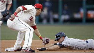 New York Yankees' Brett Gardner, right, is tagged out by Cleveland Indians' Asdrubal Cabrera in the fourth inning of a home opener baseball game.