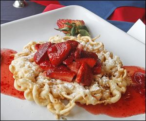 Fans can purchase a fresh strawberry funnel cake at Farr Out Funnels.
