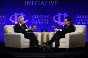 Former President Bill Clinton, left, and Comedy Central's Stephen Colbert during the Clinton Global Initiative at Washington University in St. Louis, Saturday.