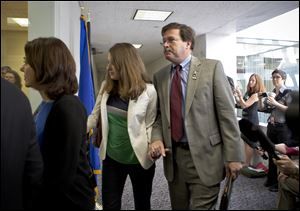 Bill Sherlach, with daughter Maura Lynn Schwartz, arrives with other families of the Newtown, Connecticut, school massacre to meet privately today on Capitol Hill in Washington.