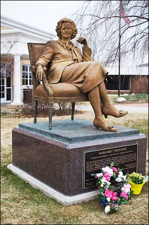 Flowers honor former British Prime Minister Margaret Thatcher at her statue at Hillsdale College after her death this week. The 'Iron Lady' was 87.