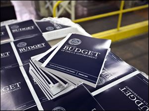 Copies of President Obama's budget plan for fiscal year 2014 are prepared for delivery at the U.S. Government Printing Office in Washington Monday.