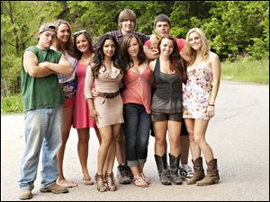 "The cast of the MTV reality series ""Buckwild,"" from left, Shain Gandee, Anna, Katie, Salwa, Joey, background center, Ashley, Tyler, background right, Cara and Shae."