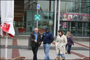 Mayor Bell, center, walks with Toledo Finance Director Patrick McLean, left, and Public Information Officer Jen Sorgenfrei, right, arrive in Delmenhorst, Germany, today.