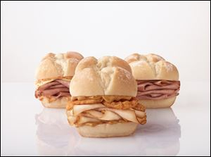 Toledo was among the 13 test markets selected for the new 'Snack 'n Save' menu at Arby's. That menu includes Mighty Minis, a slider-style sandwich that comes with hot turkey or roast beef.