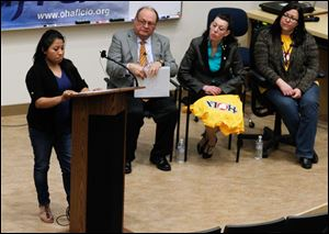 Columbus resident Maria Sanchez talks of unfairness in the work-place during a statewide meeting at the University of Toledo.