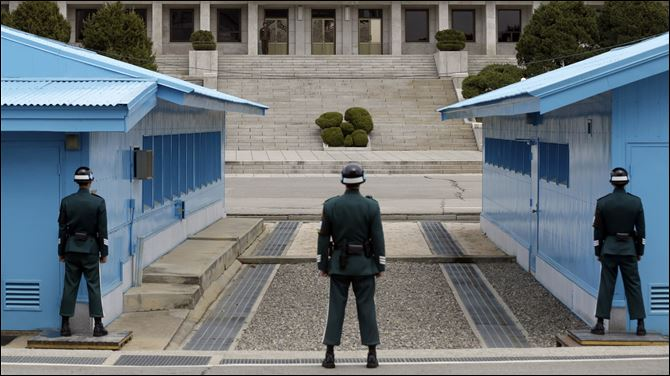 South Korea Koreas Tension A North Korean soldier, center top, looks at the southern side as South Korean soldiers stand guard at the border village of Panmunjom, which has separated the two Koreas since the Korean War, in Paju, north of Seoul, South Korea, today.
