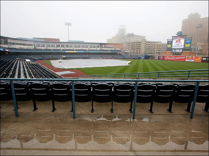 Mud Hens home opener wet 5/3 Field Seats are reflected in standing water and a tarp covers the playing surface Wednesday at Fifth Third Field. Weather permitting, the Mud Hens will play their home opener today against Louisville.