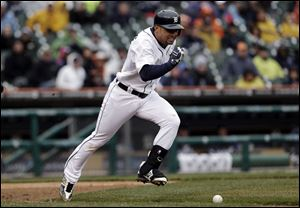 Detroit Tigers' Omar Infante runs past his bunted ball for a single against the Toronto Blue Jays in the fifth inning.