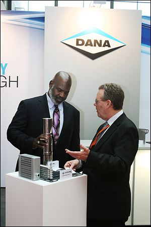 Mayor Mike Bell speaks with Dana Holding Corp.'s Brian Cheadle, director of global business development, who shows Dana's fuel cell technology.