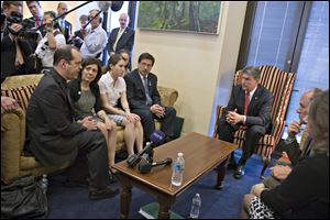 Sen. Joe Manchin, D-W.Va., seated right, meets in his office with families of victims of the  Sandy Hook Elementary School shooting in Newtown, Conn., on the day he announced that they have reached reached a bipartisan deal on expanding background checks to more gun buyers, on Capitol Hill in Washington, Wednesday. Seated on sofa from left are David and Francine Wheeler, who lost their 6-year-old son Ben in the shooting, Katy Sherlach and her father Bill Sherlach, whose wife Mary Sherlach was killed. At far right is Mark Barden, father of victim Daniel Barden.