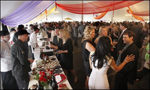 Partygoers sample foods during last year's Taste of the Nation at the Toledo Club.
