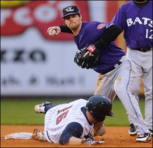 Mud Hens catcher Bryan Holaday is forced out at second base, the start of a double play turned by Louisville Bats shortstop Jason Donald in the sixth inning Thursday. The Mud Hens lost 4-1.