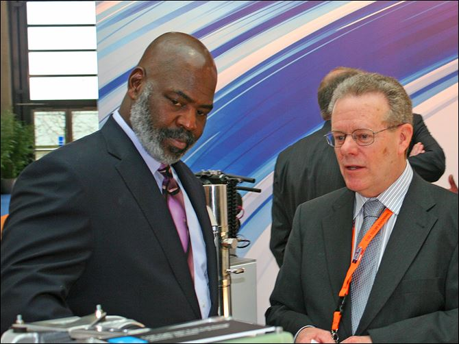 Hannover Messe, in Germany, Mayor Mike Bell In between meetings at Hannover Messe, in Germany, Mayor Mike Bell stops to talk with Dana excutives. Brian Cheadle, director of global business development, shows the mayor fuel cell technology, including its newly announced Metallic Bipolar Plates.