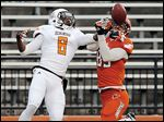 Jared Cohen, right, of the Orange, makes a catch against  Cameron Truss of the White in BGSU's spring game.