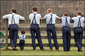Amish boys watch a game of baseball outside the school house April 9 in Bergholz, Ohio. Many Amish families gathered following the final day of school for a celebration and farewell picnic.