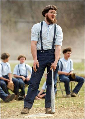 Freeman Burkholder waits for his at bat during a game of baseball at the farewell picnic April 9 in Bergholz, Ohio. The picnic was for Burkholder and other Amish people leaving for prison this week for their part in the hair and beard cutting scandal against other Amish members.