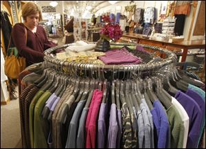 In this Tuesday, April 9, 2013 photo, a shopper looks over the clothes at the Vermont Trading Company in Montpelier, Vt.