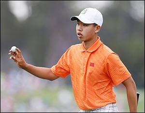 Amateur Guan Tianlang of China is the youngest player in Masters history to make the cut. He advanced despite a one-stroke penalty.