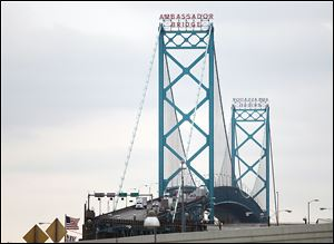 Manuel Moroun, owner of the Ambassador Bridge, has sued to block building of a second span.
