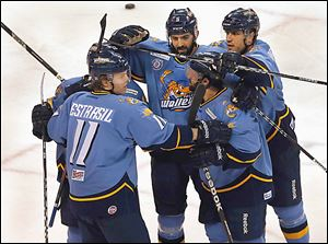 Walleye players celebrate after Travis Novak scored against the Cincinnati Cyclones in the third period.