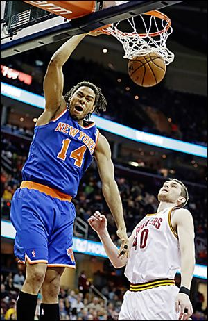 The Knicks' Chris Copeland (14) dunks over the Cavaliers' Tyler Zeller.