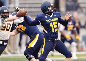 Toledo's Blue team quarterback Logan Woodside throws a pass during the spring game at the Glass Bowl on Friday.  The Gold team beat the Blue team 21-10.
